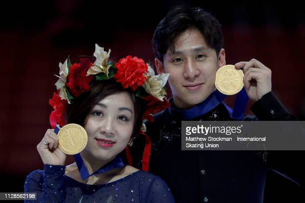Gold medalists Wenjing Sui and Cong Han of China pose for photographers after the Pairs Final during the ISU Four Continents Figure Skating...