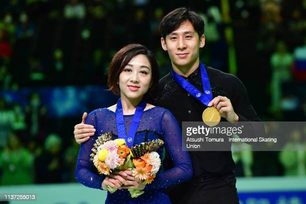 Gold medalists Wenjing Sui and Cong Han of China pose with medals during day 2 of the ISU World Figure Skating Championships 2019 at Saitama Super...