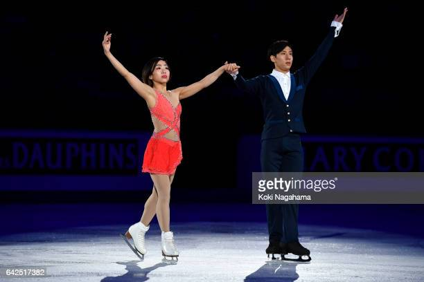Gold medalists Wenjing Sui and Cong Han of China wave for fans prior to the medals ceremony of the Pairs during ISU Four Continents Figure Skating...