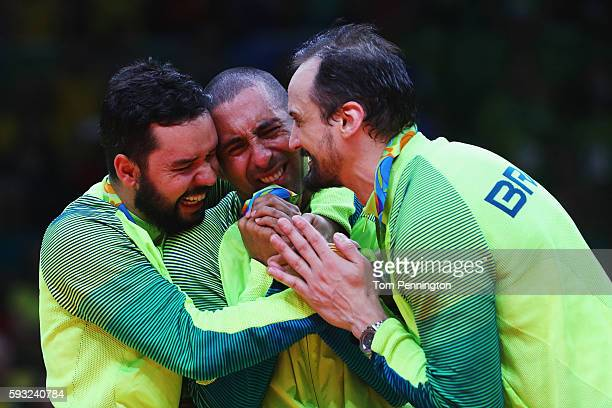 Gold medalists William Arjona of Brazil and Luiz Felipe Marques Fonteles of Brazil celebrate with Sergio Dutra Santos of Brazil during the medal...