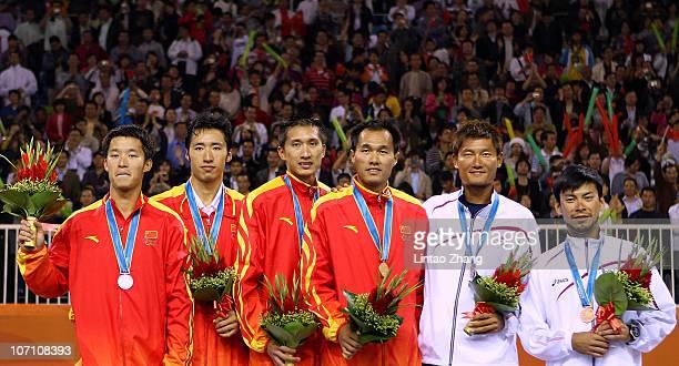 Gold medalists Xu Linyin and Wu Penggen silver medalists Li Jian and Gao Peng of China and bronze medalists Asahi Kentaro and Shiratori Katsuhiro of...