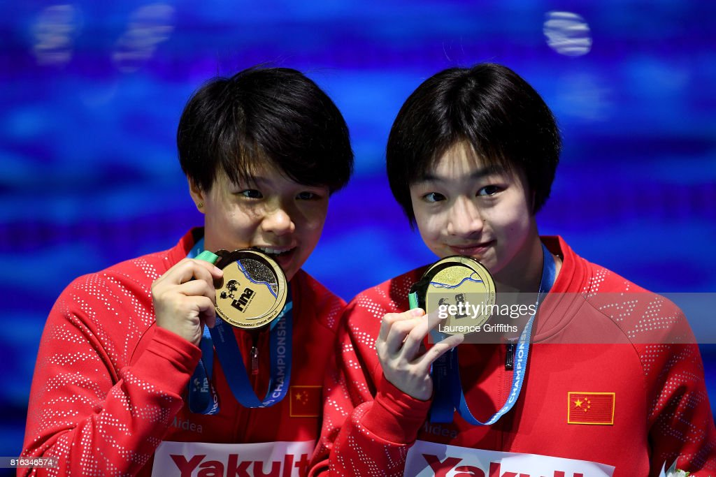 Gold medalists Yani Chang and Tingmao Shi of China pose with the medals won during the Women's Diving 3M Synchro Springboard final on day four of the Budapest 2017 FINA World Championships on July 17, 2017 in Budapest, Hungary.