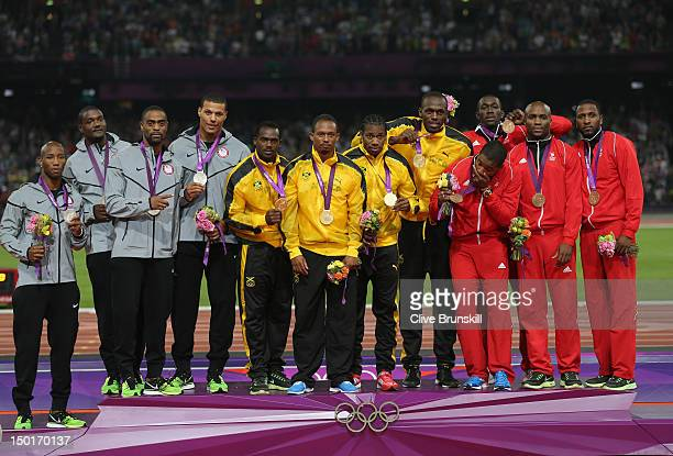 Gold medalists Yohan Blake Usain Bolt Nesta Carter and Michael Frater of Jamaica silver medalists Trell Kimmons Justin Gatlin Tyson Gay and Ryan...