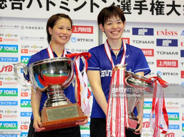 Gold medalists Yuki Fukushima and Sayaka Hirota celebrate at the medal ceremony for the Women's Doubles on day seven of the Japanese National...