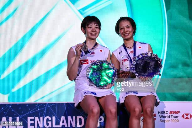 Gold medalists Yuki Fukushima and Sayaka Hirota of Japan pose with their trophies on the podium after winning the Women's Doubles final match against...