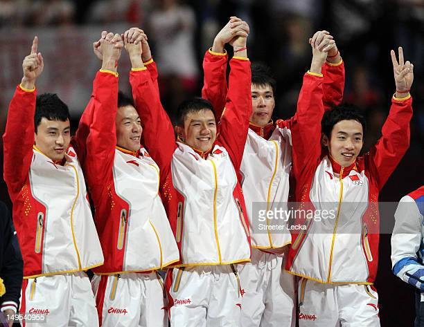 Gold medalists Zhe Feng Weiyang Guo Yibing Chen Chenglong Zhang and Kai Zou of China pose on the podium during the medal ceremony in the Artistic...