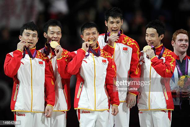 Gold medalists Zhe Feng Weiyang Guo Yibing Chen Chenglong Zhang and Kai Zou of China celebrate on the podium during the medal ceremony in the...
