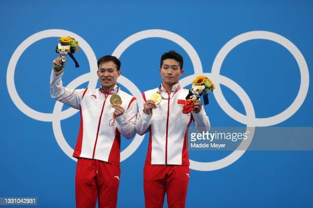 Gold medalists Zongyuan Wang and Siyi Xie of Team China pose during the medal ceremony for the Men's Synchronised 3m Springboard final on day five of...