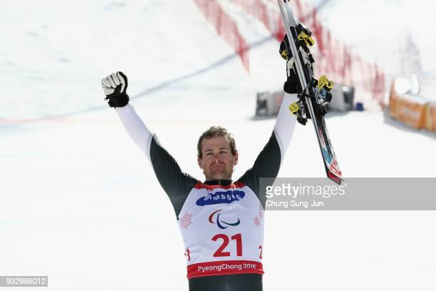 Gold medallist Adam Hall of New Zealand celebrates during the victory ceremony for the Alpine Skiing Men's Slalom Standing on day eight of the...
