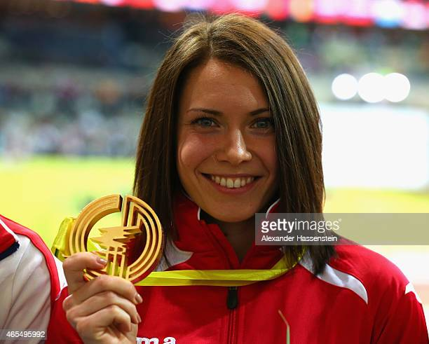 Gold medallist Alina Talay of Belarus poses on the podium during the medal ceremony for the Women's 60 metre Hurdles during day two of the 2015...