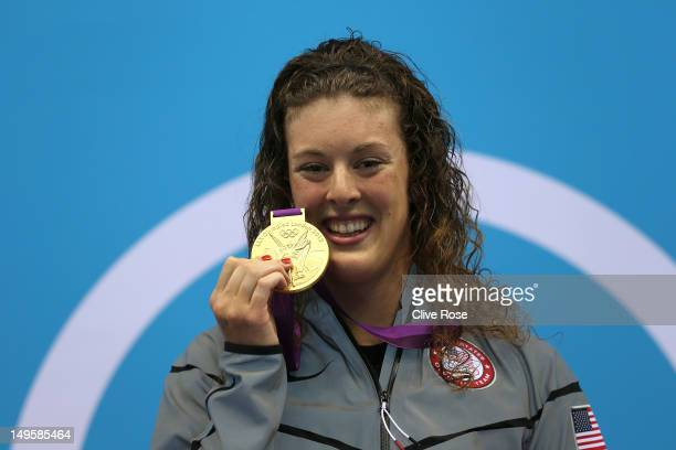 Gold medallist Allison Schmitt of the United States poses on the podium during the medal ceremony for the Women's 200m Freestyle final on Day 4 of...