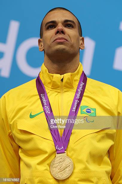 Gold medallist Andre Brasil of Brazil poses on the podium during the medal ceremony for the Men's 50m Freestyle S10 Final on day 2 of the London 2012...