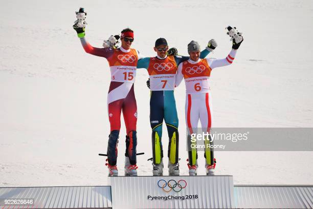 Gold medallist Andre Myhrer of Sweden celebrates with silver medallist Ramon Zenhaeusern of Switzerland and bronze medallist Michael Matt of Austria...
