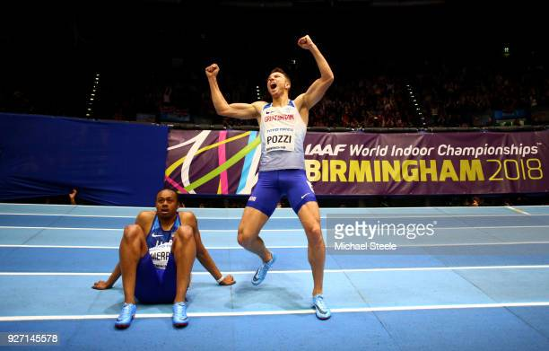 Gold Medallist Andrew Pozzi of Great Britain celebrates winning the Men's 60 Metres Hurdles Final as Aries Merritt of United States looks dejected...