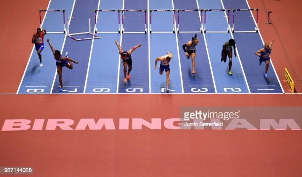 Gold Medallist Andrew Pozzi of Great Britain dips for the line to win the Men's 60 Metres Hurdles Final during the IAAF World Indoor Championships on...
