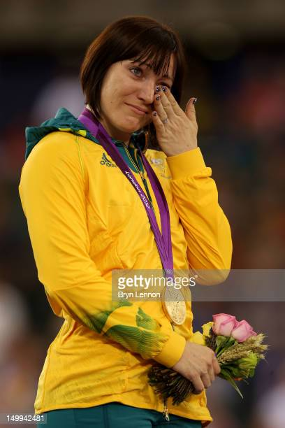 Gold medallist Anna Meares of Australia cries as she celebrates during the medal ceremony for the Women's Sprint Track Cycling Final on Day 11 of the...