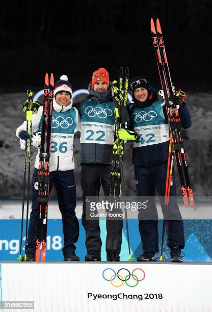 Gold medallist Arnd Peiffer of Germany poses with silver medallist Michal Krcmar of the Czech Republic and bronze medallist Dominik Windisch of Italy...