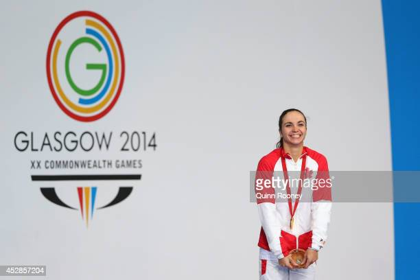Gold medallist Audrey Lacroix of Canada stands on the podium during the medal ceremony for the Women's 200m Butterfly Final at Tollcross...