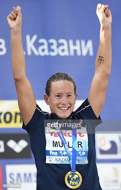 Gold medallist Aurelie Muller of France celebrates during the medal ceremony for the Women's 10km Open Water Swimming Final on day four of the 16th...