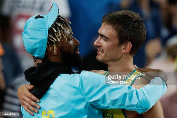 Gold medallist Australia's Brandon Starc hugs silver medallist Bahamas' Jamal Wilson after the athletics men's high jump final during the 2018 Gold...