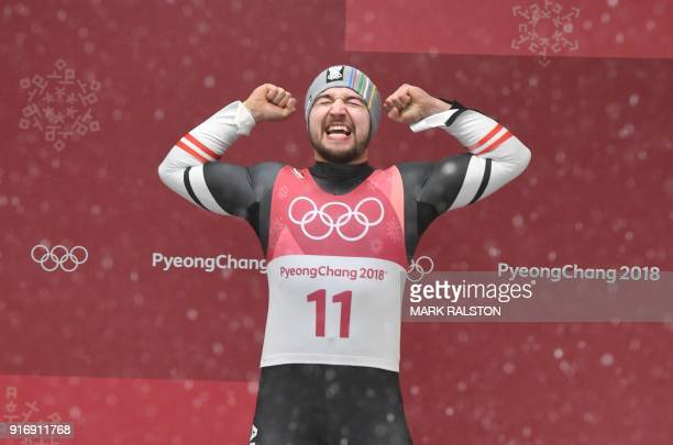 TOPSHOT Gold medallist Austria's David Gleirscher celebrates after winning the men's luge singles during the Pyeongchang 2018 Winter Olympic Games at...