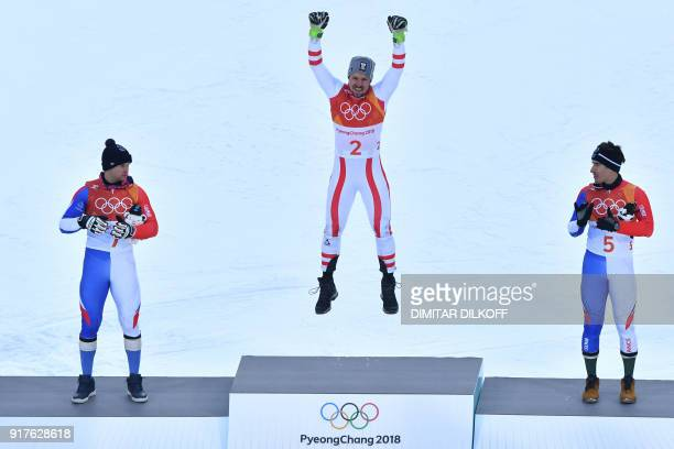 Gold medallist Austria's Marcel Hirscher celebrates on the podium next to France's Alexis Pinturault silver medal and France's Victor MuffatJeandet...