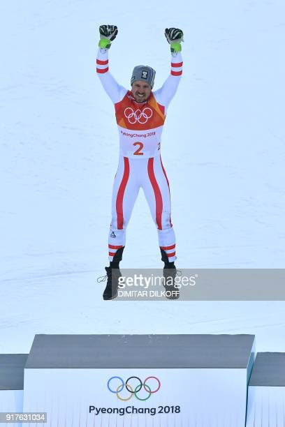 Gold medallist, Austria's Marcel Hirscher celebrates on the podium during the victory ceremony after the Men's Alpine Combined at the Jeongseon...