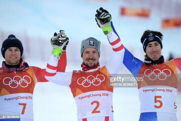 Gold medallist Austria's Marcel Hirscher celebrates with France's Alexis Pinturault silver medal and France's Victor MuffatJeandet bronze during the...