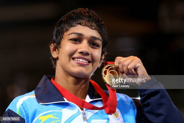 Gold medallist Babita Kumari of India poses during the medal ceremony for the Women's FS 55kg at Scottish Exhibition and Conference Centre during day...