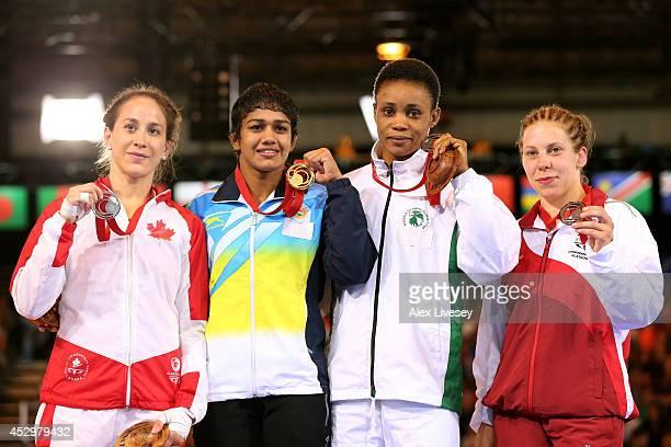 Gold medallist Babita Kumari of India poses with silver medallist Brittanee Laverdure of Canada and bronze medallists Ifeoma Nwoye of Nigeria and...