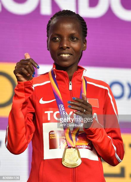 Gold medallist Bahrain's Rose Chelimo takes part in a medal ceremony after the women's marathon athletics event at the 2017 IAAF World Championships...