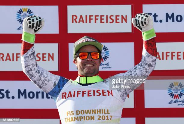 Gold medallist Beat Feuz of Switzerland celebrates during the flower ceremony for the Men's Downhill during the FIS Alpine World Ski Championships on...
