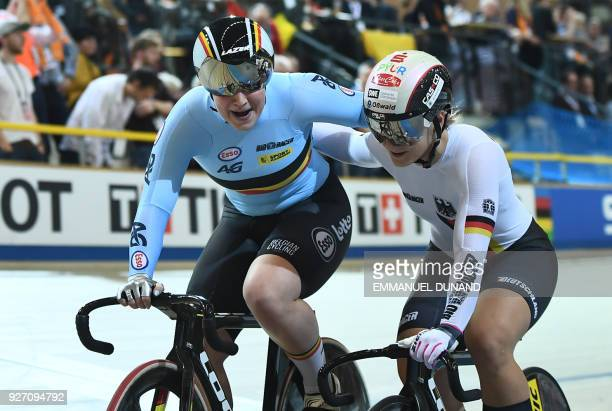 Gold medallist Belgium's Nicky Degrendele and Germany's Kristina Vogel hug after the women's keirin final during the UCI Track Cycling World...