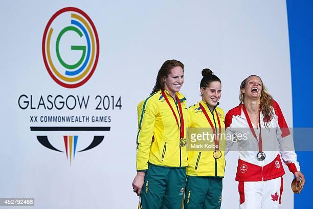 Gold medallist Belinda Hocking of Australia poses with silver medallist Emily Seebohm of Australia and bronze medallist Hilary Caldwell of Canada...