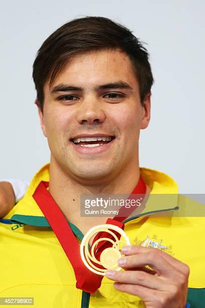 Gold medallist Ben Treffers of Australia poses during the medal ceremony for the Men's 50m Backstroke Final at Tollcross International Swimming...
