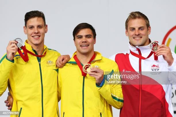 Gold medallist Ben Treffers of Australia poses with silver medallist Mitch Larkin of Australia and bronze medallist Liam Tancock of England during...