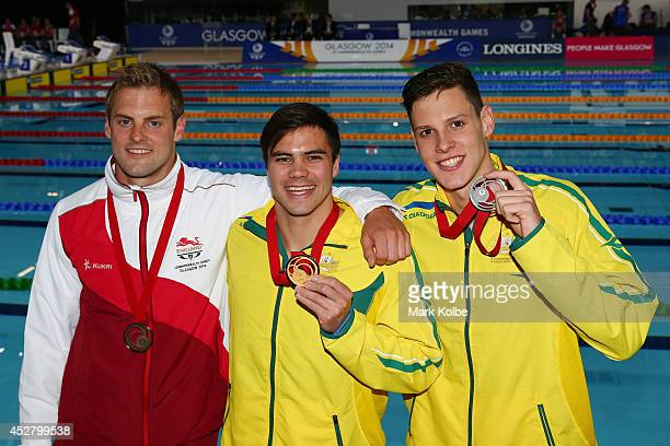 Gold medallist Ben Treffers of Australia poses with silver medallist Mitch Larkin of Australia and bronze medallist Liam Tancock of England after the...