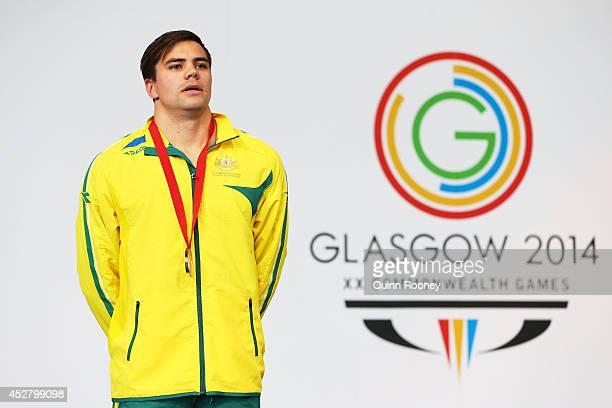 Gold medallist Ben Treffers of Australia stands on the podium during the medal ceremony for the Men's 50m Backstroke Final at Tollcross International...
