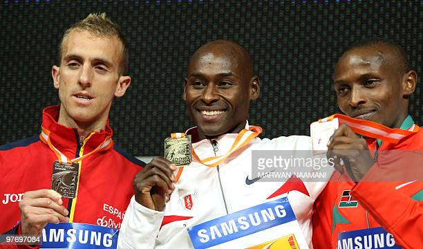 Gold medallist Bernard Lagat of the US poses on the podium with Spain's Sergio Sanchez and Kenya's Sammy Alex Mutahi who won silver and bronze...