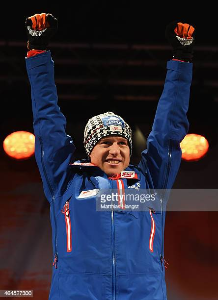 Gold medallist Bernhard Gruber of Austria celebrates during the medal ceremony for the Men's Nordic Combined HS134 Large Hill Ski Jumping/10km...