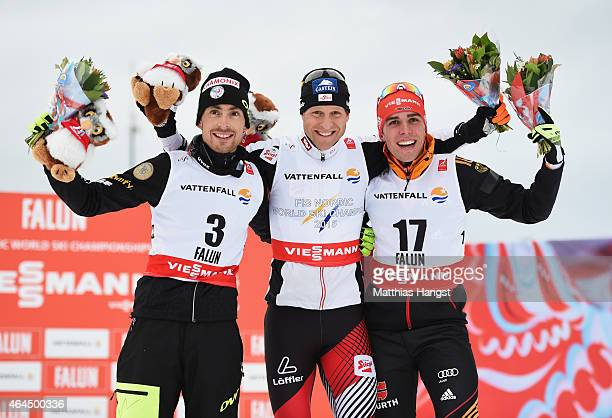 Gold medallist Bernhard Gruber of Austria poses with silver medallist Francois Braud of France and bronze medallist Johannes Rydzek of Germany after...