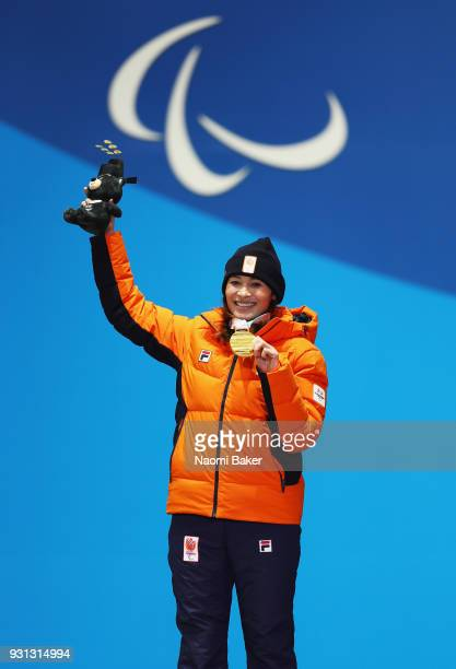 Gold medallist Bibian MentelSpee of Netherlands celebrates during the medal ceremony for the Women's Snowboard Cross SBLL2 during day four of the...