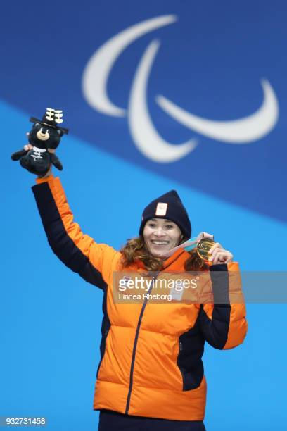 Gold medallist Bibian MentelSpee of Netherlands celebrates during the medal ceremony for the Women's Snowboard Banked Slalom SBLL2 Final on day seven...