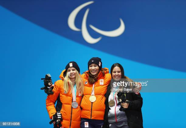 Gold medallist Bibian MentelSpee of Netherlands celebrates with Bronze medallist Astrid Fina Paredes of Spain and Silver medallist Renske van Beek of...