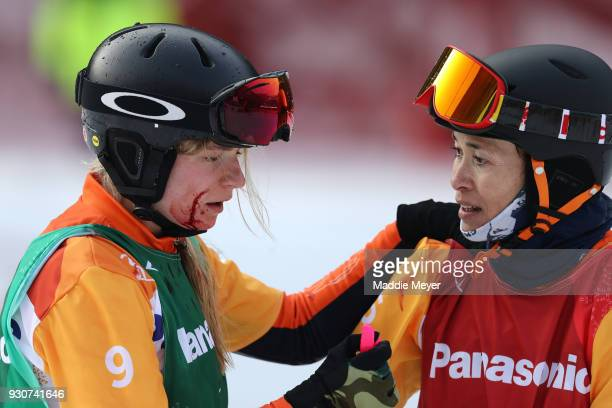 Gold medallist Bibian MentelSpee of Netherlands comforts injured Silver medallist and fellow countrywoman Renske van Beek in the Women's Snowboard...