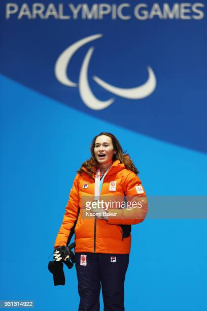 Gold medallist Bibian MentelSpee of Netherlands sings the national anthem during the medal ceremony for the Women's Snowboard Cross SBLL2 during day...