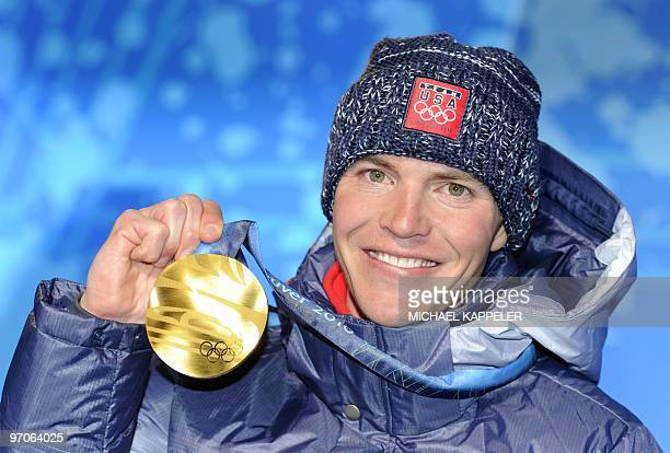 US Gold medallist Bill Demong is seen during the medal ceremony for the Nordic combined Long Hill/ 10km individual event of the Vancouver 2010 Winter...
