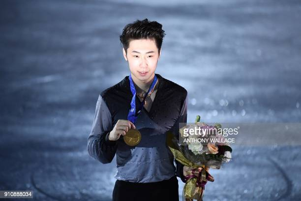 TOPSHOT Gold medallist Boyang Jin of China poses on the rink during the victory ceremony for the men's free skating program at the ISU Four...