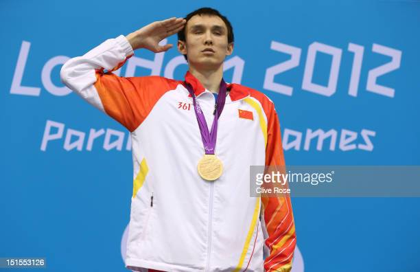 Gold medallist Bozun Yang of China and bronze medallist Oleksandr Maschenko of Ukraine pose on the podium during the medal ceremony for the Men's...
