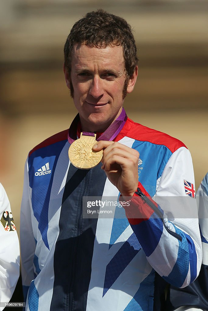 Gold medallist Bradley Wiggins of Great Britain celebrate during the victory ceremony after the Men's Individual Time Trial Road Cycling on day 5 of the London 2012 Olympic Games on August 1, 2012 in London, England.